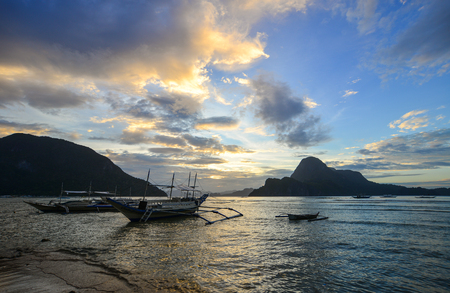 Sunset on the sea with boats in Palawan, Philippines. Palawan is one of the Philippine Islands top vacation destinations for foreign tourists. Stock Photo