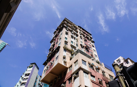 Hong Kong - Apr 1, 2017. Old apartments under blue sky in Hong Kong, China. Hong Kong is an important hub in East Asia with global connections to many of the world cities. Editorial