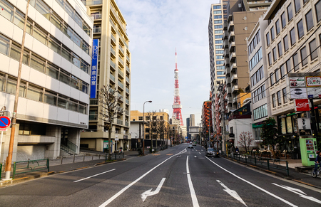 Tokyo, Japan - Jan 3, 2016. View of street with Tokyo Tower at Taito District in Tokyo, Japan. Tokyo urban area 38 million people had a total GDP of 2 trillion USD in 2012.