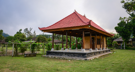 A Public Hall at Ulun Danu Temple Complex in Bali, Indonesia. Bali is a popular tourist destination, which has seen a significant rise in tourists since the 1980s. Editorial