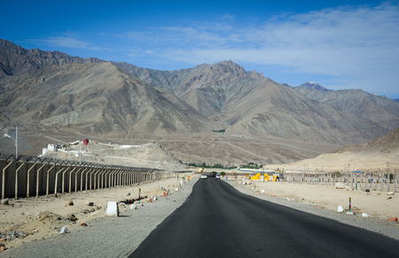Ladakh, India - Jul 16, 2015. View of National Road in Ladakh, India. Ladakh is the highest plateau in the state of Jammu & Kashmir with much of it being over 3,000m.