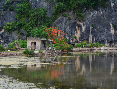 Mountain house with lake at Cat Ba Island in North of Vietnam. Cat Ba is an well-known archipelago with a spectacular array of sea and island scenery.
