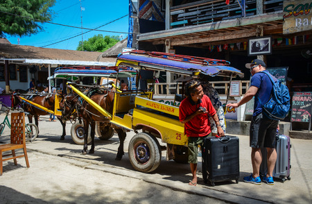 Lombok, Indonesia - Apr 19, 2016. Horse cart parking on street in Lombok Island, Indonesia. Lombok is an island next to Bali where the tourism is still in its infancy.