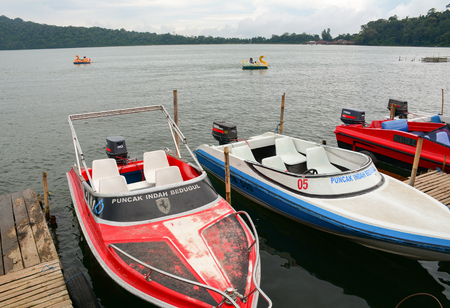 Bali, Indonesia - Apr 20, 2016. Speedboats on Lake Beratan in Bali, Indonesia. Beratan Lake is located next to Mount Bratan and Mount Catur. It is the second largest lake in Bali.