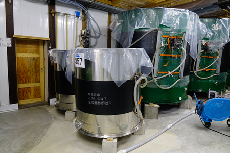 manufacturer: Akita, Japan - May 18, 2017. Machines at Sake brewery in Akita, Japan. Sake is a Japanese rice wine made by fermenting rice that has been polished to remove the bran.