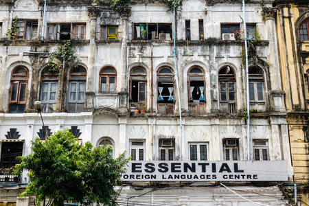 recently: Yangon, Myanmar - Feb 26, 2016. Old colonial buildings in Yangon, Myanmar. Yangon is no longer the capital of Myanmar, but it has experienced a huge increase in tourism recently.