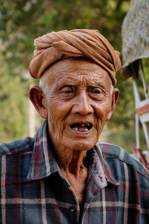 herder: Mandalay, Myanmar - Feb 22, 2016. Portrait of an old man in Mandalay, Myanmar. Mandalay is the second largest city in Burma (after Yangon), and a former capital of Myanmar.