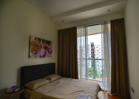 most popular: Singapore - Jun 12, 2017. Interior of a bed room at modern hotel in Singapore. Singapore is one of the most popular travel destinations in the world for a lot of reasons.