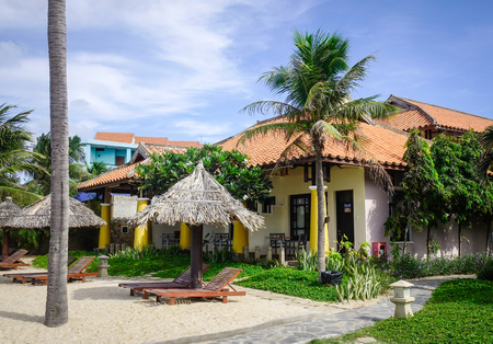 inground: Phan Thiet, Vietnam - Mar 26, 2017. Wooden shacks at luxury resort in Phan Thiet, Vietnam. Phan Thiet belongs to Binh Thuan province and located 200km South of Cam Ranh Bay.