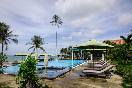 inground: Phan Thiet, Vietnam - Mar 26, 2017. Swimming pool at a luxury resort in Phan Thiet, Vietnam. Phan Thiet belongs to Binh Thuan province and located 200km South of Cam Ranh Bay.