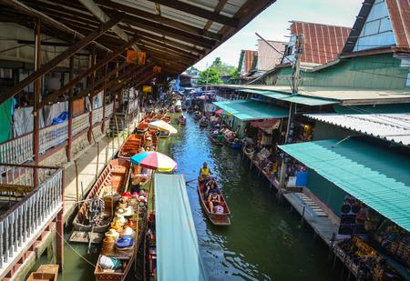 saduak: Bangkok, Thailand - Jun 19, 2017. Damnoen Saduak floating market in Bangkok, Thailand. This is the most famous of the floating markets in Thailand.