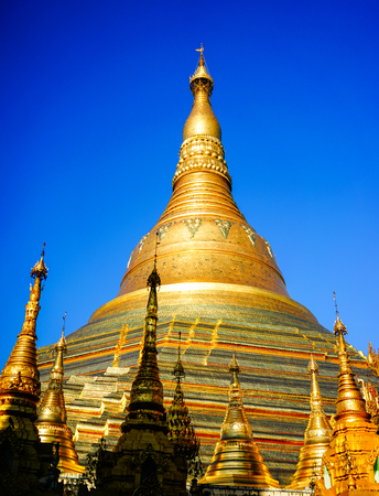 Golden Stupa of Shwedagon Pagoda at sunrise in Yangon, Myanmar. Shwedagon Pagoda or Paya is the biggest and the grandest Pagoda in Myanmar.