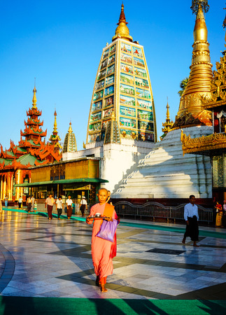 Yangon, Myanmar - Oct 16, 2015. Local people walking at Shwedagon Pagoda in Yangon, Myanmar. The Shwedagon Pagoda is one of the most famous pagodas in the world.