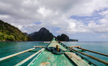 A wooden boat on the sea near Coron Island, Philippines. Coron is the third-largest island in the Calamian Islands in northern Palawan.
