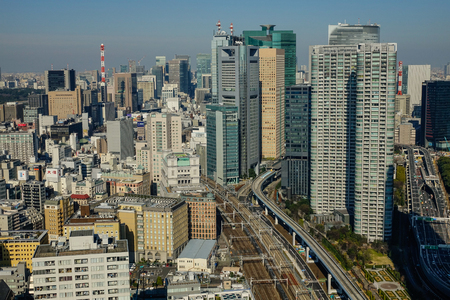 Tokyo, Japan - Jan 4, 2016. Aerial view of business district in Tokyo, Japan. Tokyo, the capital of Japan, is a megacity that is central to the country government, economy, and culture.