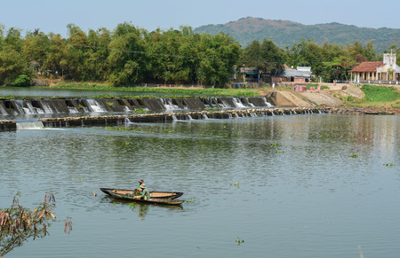 People fishing on the river at sunny day in Phu Yen, Vietnam. Stock Photo