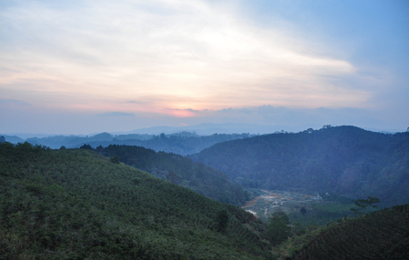 Mountain scenery at sunset on Dalat Highlands in Vietnam. Da Lat is located 1,500 m above sea level on the Langbian Plateau.