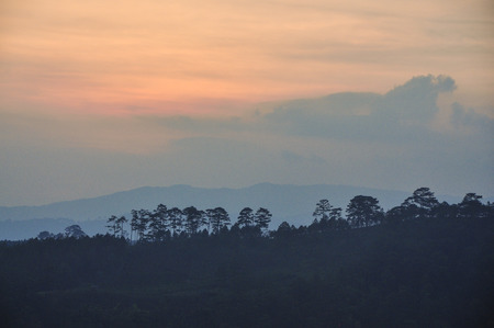 Mountain scenery on Dalat Highlands at sunset in Vietnam. Da Lat is located 1,500 m above sea level on the Langbian Plateau.