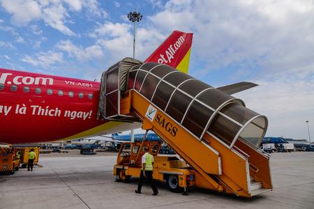 traffic controller: Saigon, Vietnam - Feb 27, 2016. A Vietjet aircraft docking at the airport in Saigon (Hochiminh City), Vietnam. Vietjet is an international low-cost airline from Vietnam.