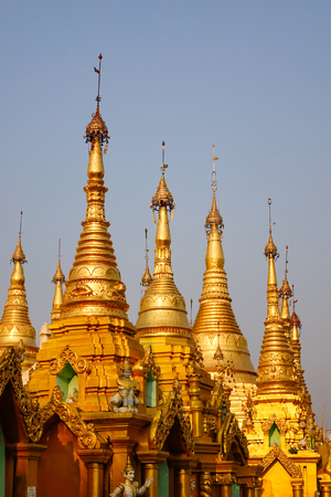 Top of golden stupas at Shwedagon Pagoda in Yangon, Myanmar. Shwedagon is one of the most famous pagodas in the world.