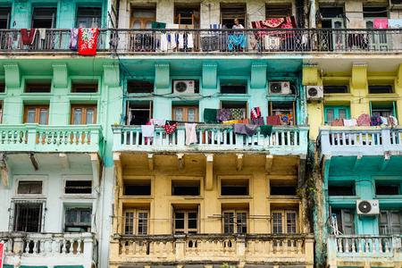 recently: Yangon, Myanmar - Feb 26, 2016. Old apartment in Yangon, Myanmar. Yangon is no longer the capital of Myanmar, but it has experienced a huge increase in tourism recently.