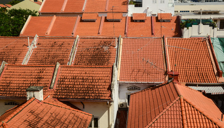 painted wood: Roof top of brick houses at downtown in Singapore.