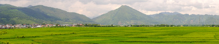 Panorama view of rice field with mountains in Northern Vietnam. Vietnam is one of world richest agricultural regions and is the second-largest exporter worldwide. Stock Photo