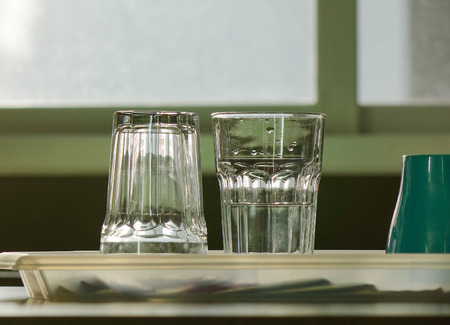 Empty glass cups on a case in modern kitchen. Close up.