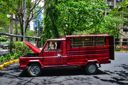 Manila, Philippines - Apr 14, 2017. An old jeepney parking on street in Manila, Philippines. Manila is a major center for commerce, banking and finance in Philippines.