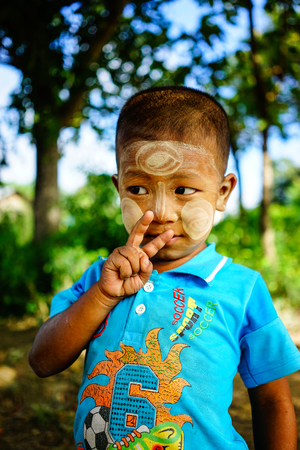 Yangon, Myanmar - Oct 17, 2015. Portrait of a boy at the village in Yangon, Myanmar. The total population in Myanmar was estimated at 52.9 million people in 2016. Editorial