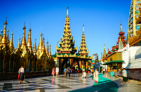 Yangon, Myanmar - Oct 16, 2015. Local people walking at the Shwedagon Pagoda in Yangon, Myanmar. The Shwedagon Pagoda is one of the most famous pagodas in the world. Editorial