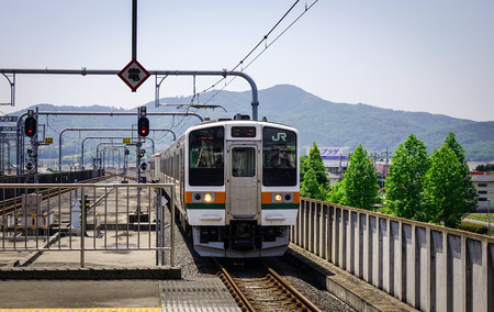 Ashikaga, Japan - May 20, 2017. A JR train coming to railway station in Ashikaga, Japan. Railways are the most important means of passenger transportation in Japan.