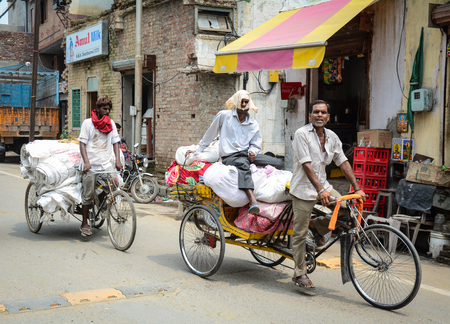 Amritsar, India - Jul 25, 2015. Men riding rickshaw in Amritsar, India. Amritsar is a holy city in the state of Punjab in India. It lies about 25 km east of the border with Pakistan.