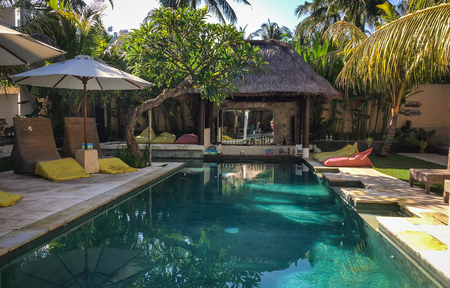 inground: Lombok, Indonesia - Apr 16, 2016. Swimming pool of resort in Lombok, Indonesia. Lombok is an island east of Bali, but less famous than its neighbor.