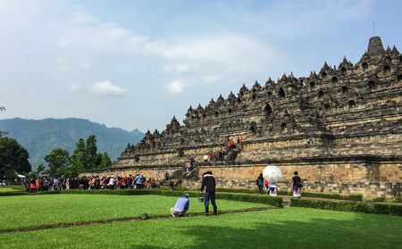Yogya, Indonesia - Apr 15, 2016. People visit Borobudur Temple in Yogya, Indonesia. Borobudur is a Buddhist stupa and temple complex in Central Java, dating from the 8th century. Editorial