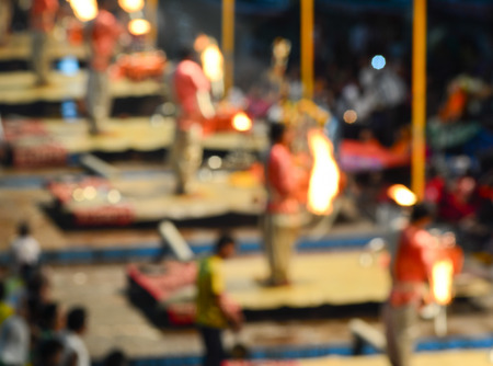 benares: Indian Brahmins conducts religious Ganga Maha Aarti ceremony (fire puja). Out of focus with bokeh, for background.
