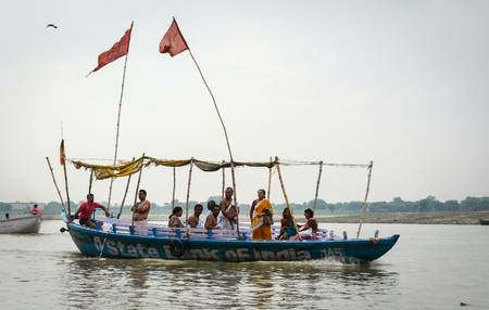 Varanasi, India - Jul 12, 2015. A tourist boat runs on Ganges River at misty day in Varanasi, India. Varanasi, once known as Benares or Banaras, is a historical city in northern India.