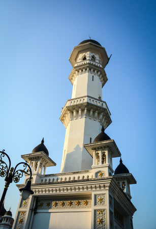 Main tower of mosque in Penang, Malaysia. Penang is a Malaysian state located on the northwest coast of Peninsular Malaysia, by the Malacca Strait. Stock Photo