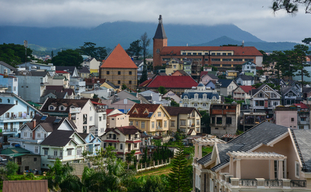 Dalat, Vietnam - Jul 5, 2016. Aerial view of downtown in Dalat, Vietnam. Da Lat in Central Highlands, is centered around a lake and golf course, and surrounded by hills, pine forests.