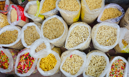 Close-up of dried foods for sale at Chandni Chowk Market in Old Delhi, India. The Chandni Chowk (Moonlight Square) is one of the oldest markets in Old Delhi.