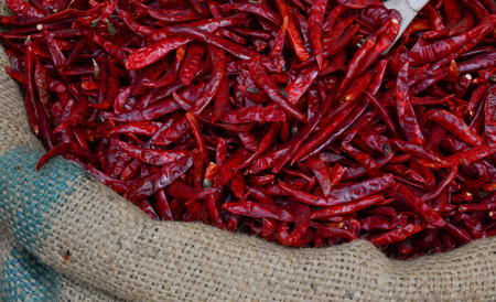 Close-up of dried chilli peppers at Chandni Chowk Market in Old Delhi, India. The Chandni Chowk (Moonlight Square) is one of the oldest markets in Old Delhi. Stock Photo