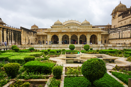 trusted: Jaipur, India - Jul 28, 2015. Amer Fort with the garden in Jaipur, India. In 16th century, the fort was built by a trusted general of Akbar, Maan Singh.