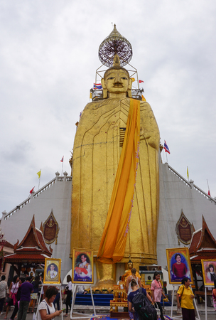 Bangkok, Thailand - Jul 30, 2015. Huge Buddha statue at Wat Intharawihan in Bangkok, Thailand. The temple is known for its enormous 32 meters high standing Buddha image.