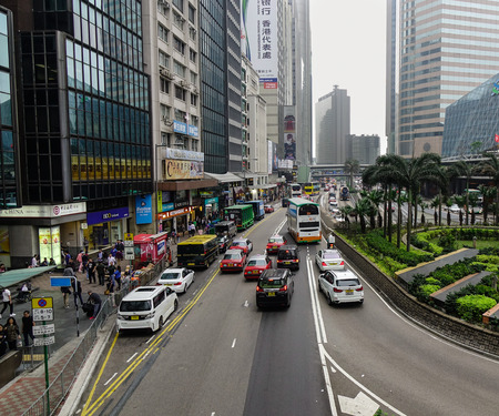 Hong Kong - Mar 30, 2017. Cars run on street at Causeway District in Hong Kong, China. Hong Kong ranks as the world fourth most densely populated sovereign state or territory.
