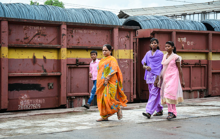 gaya: Bodh Gaya, India - Jul 9, 2015. Indian women walking on street in Bodhgaya, India. Bodhgaya (Bodh Gaya) is the site of the Buddha enlightenment and the holiest of four main Buddhist.