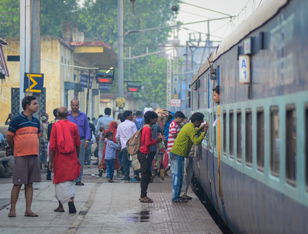gaya: Gaya, India - Jul 9, 2015. People at Gaya Station in India. Indian Railways is the fourth largest railway network in the world comprising 119,630 kilometres of total track.