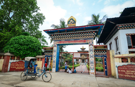 ordain: Bodh Gaya, India - Jul 9, 2015. Gate of Royal Bhutanese Monastery in Bodhgaya, India. Bodh Gaya has temples or monasteries from many other nations with a Buddhist tradition. Editorial