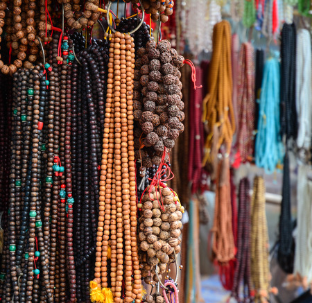 The largest collection of rosaries for sale at street market in Bodhgaya, India.