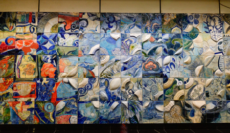 Singapore - Dec 14, 2015. Ceramic wall at subway station in Singapore. Singapore, referred to as the Lion City, the Garden City, is a sovereign city-state in Southeast Asia. Editorial