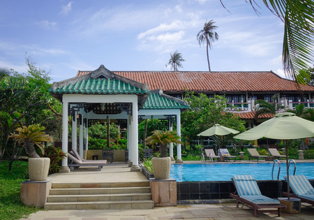 inground: Phan Thiet, Vietnam - Jun 3, 2017. Swimming pool at a luxury resort in Phan Thiet, Vietnam. Phan Thiet belongs to Binh Thuan province and located 200km South of Cam Ranh Bay.